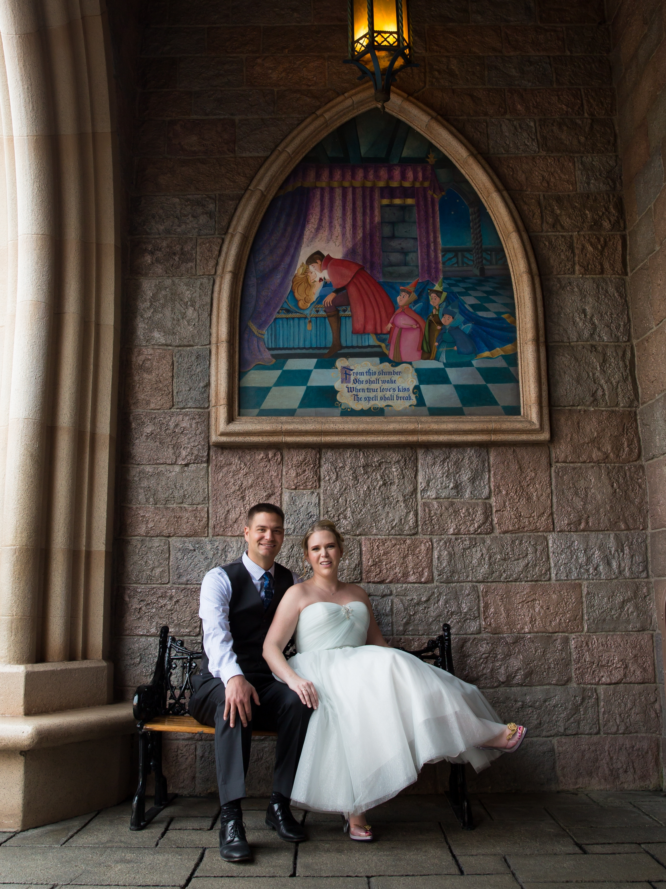 Julie with her husband in Sleeping Beauty's Castle at Disneyland.