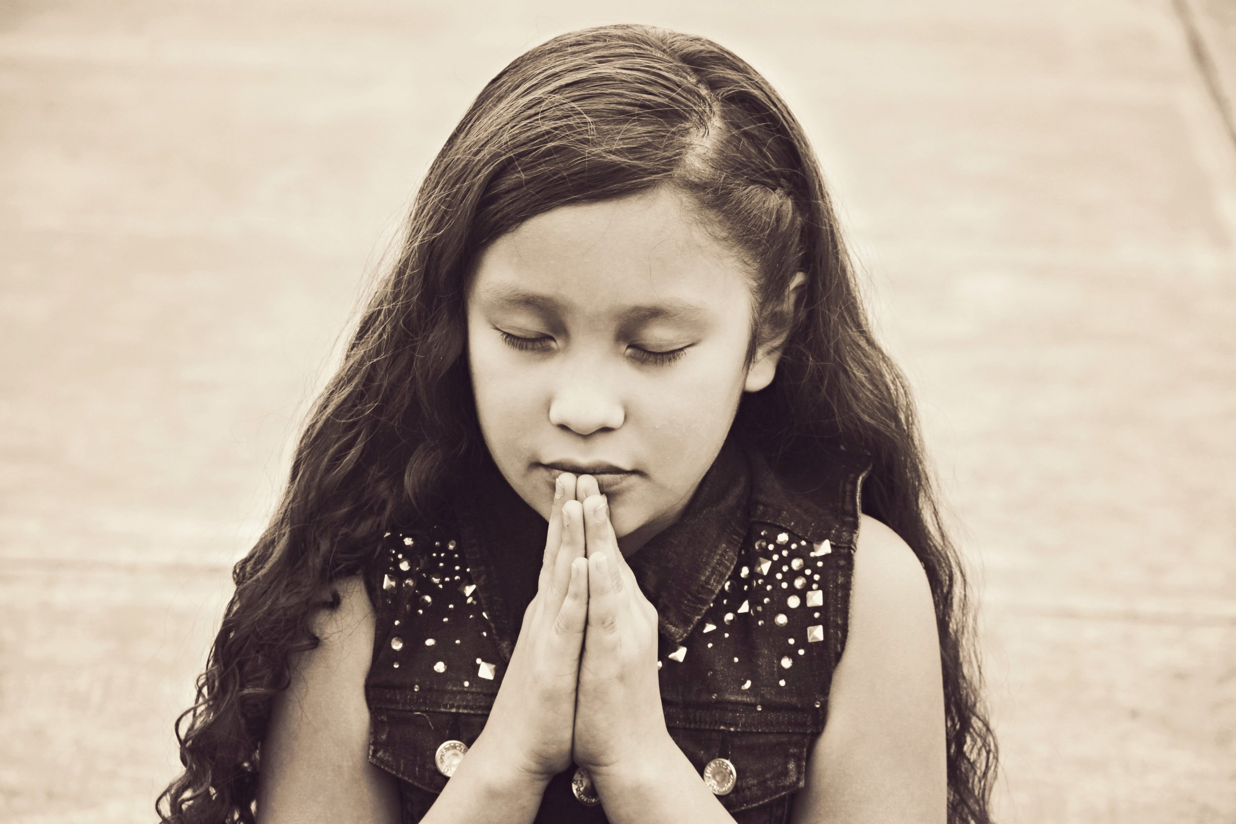 Praying Child Christian Stock Photo.jpg