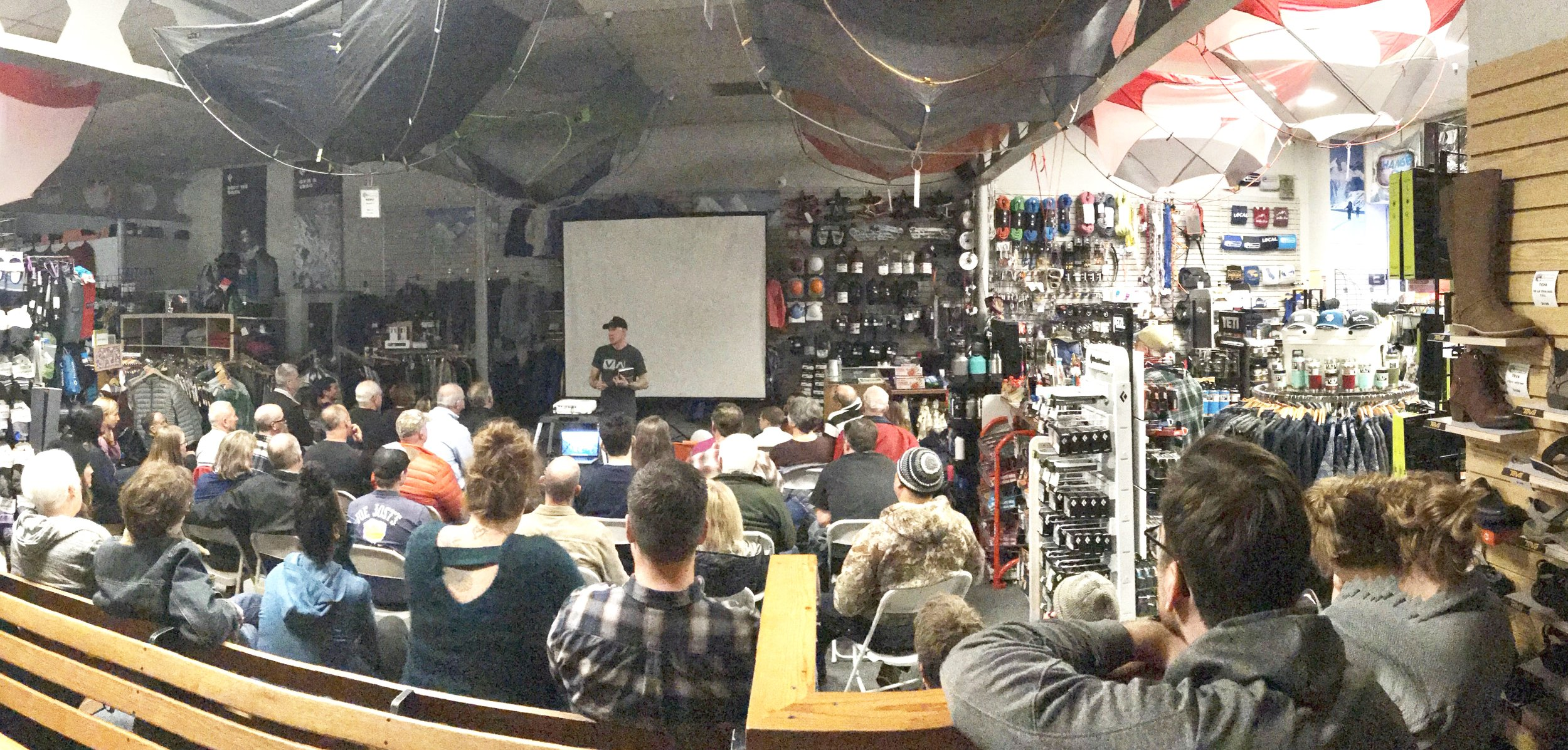 Dean giving a SAR presentation at an outdoor retailer
