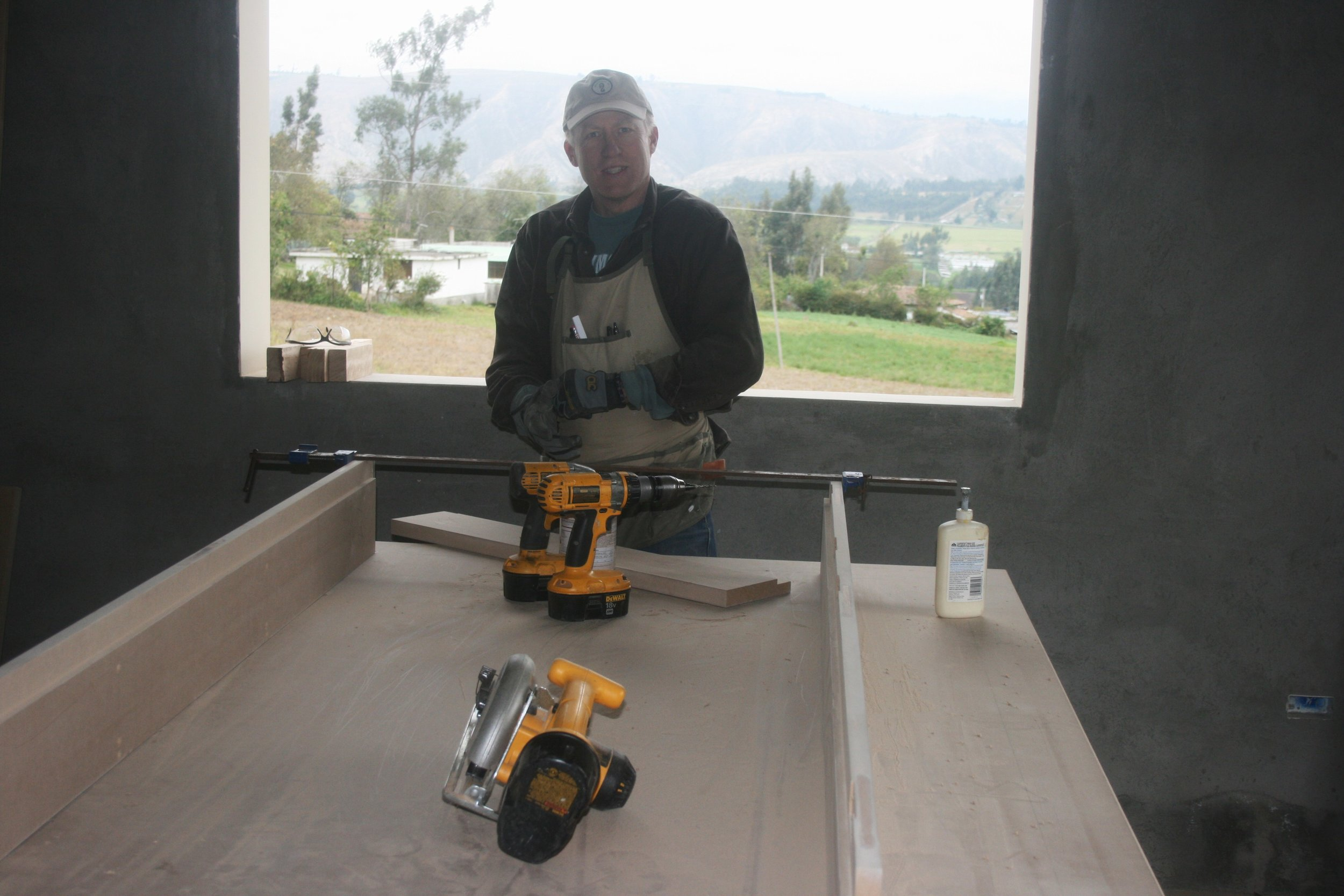 Dean fabricating door jambs for the Latancunga home