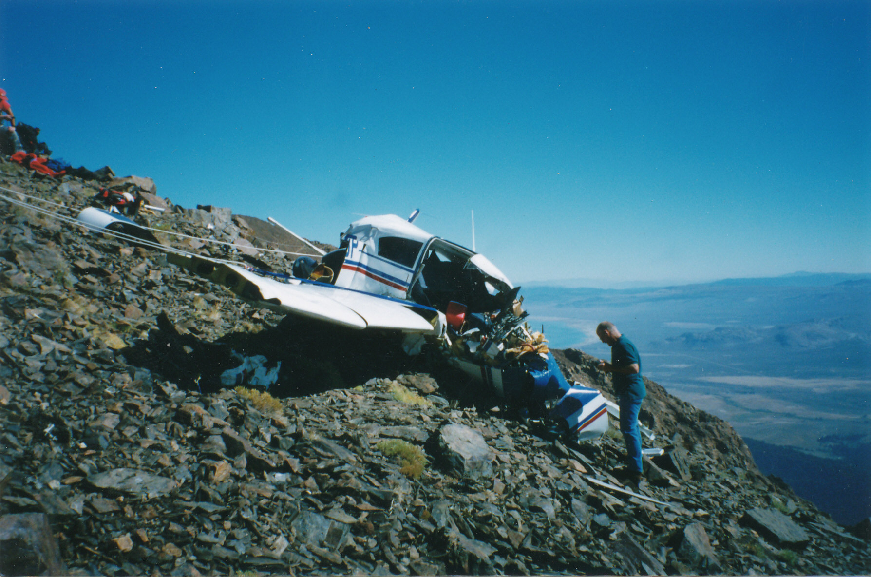 Recovering the remains of two victims of a plane crash at 11,000 feet