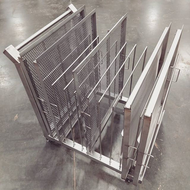 Custom stainless steel cart and sifting screens.