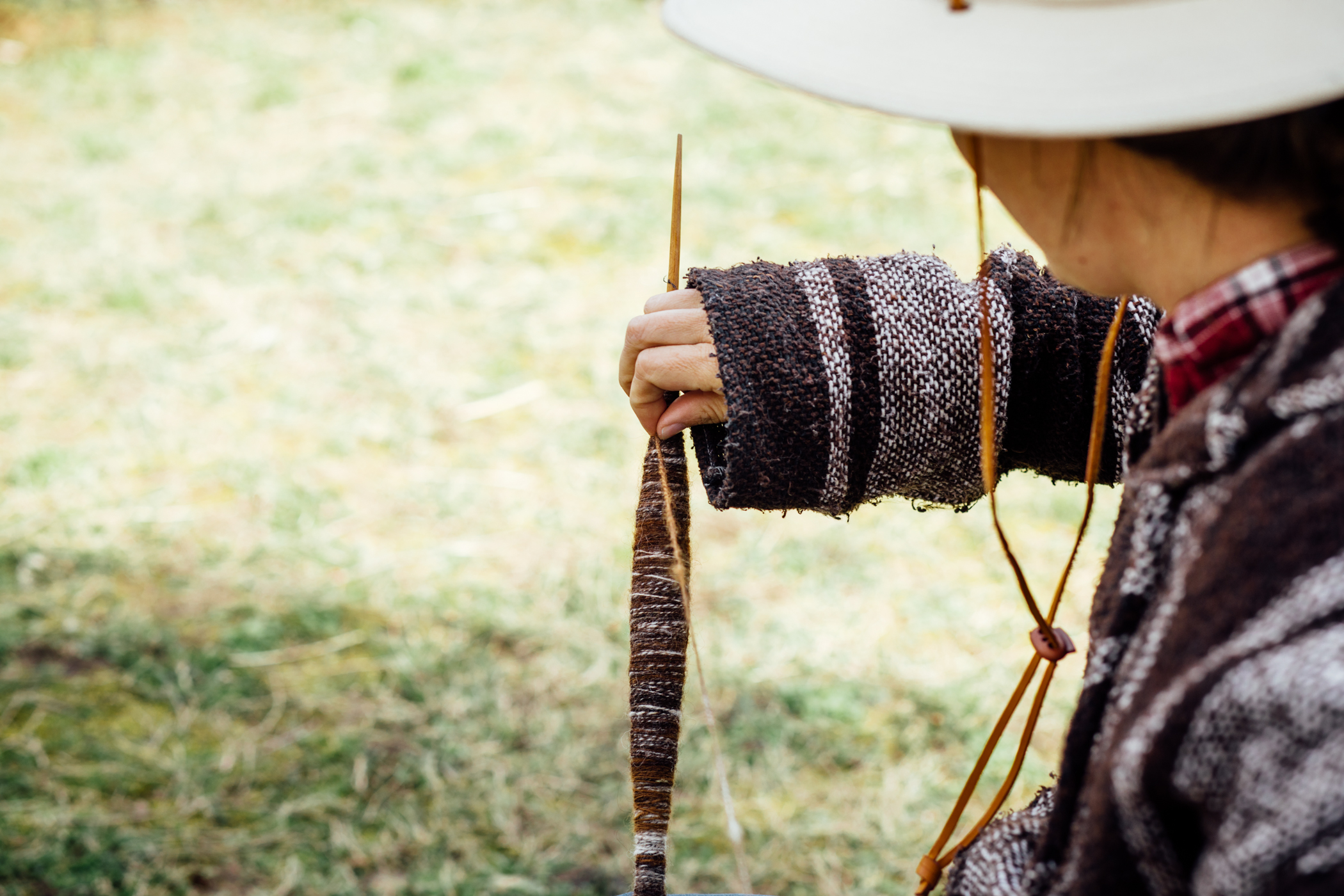 Spinning Alpaca fiber on a support spindle: image by Grace Boto