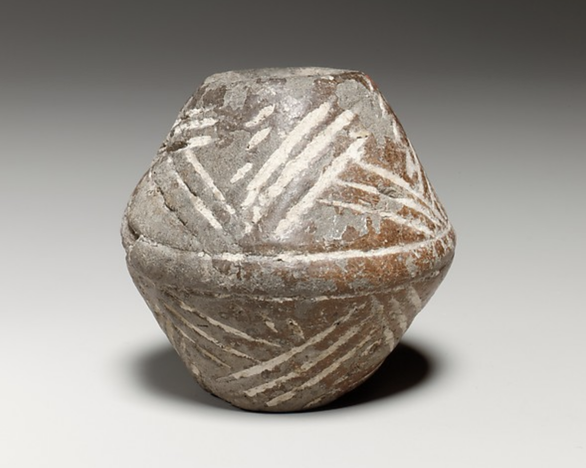 Terracotta whorl, 2,500-2,075 BCE, Cypriot (Cyprus) - The Metropolitan Museum of Art   https://www.metmuseum.org/art/collection/search/240529