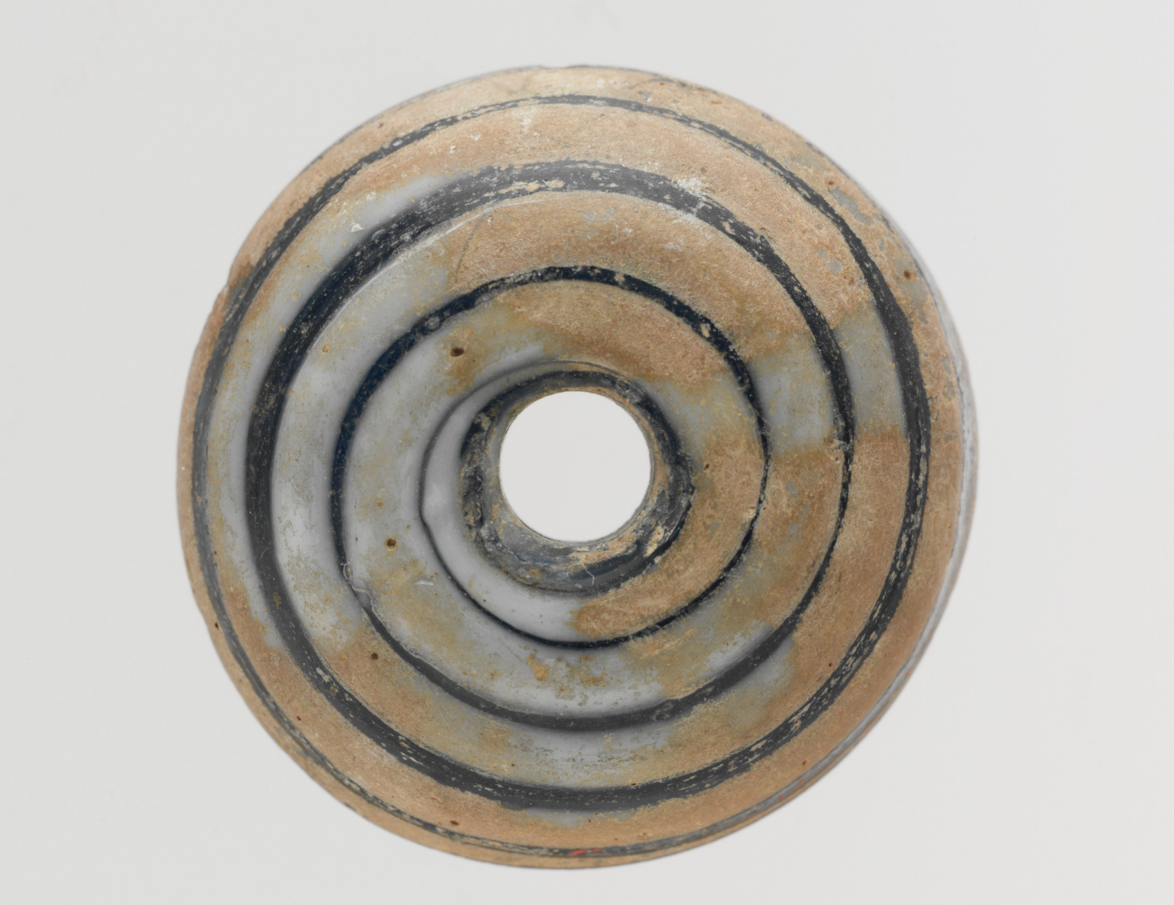 Glass whorl, c0-200 CE, Roman - The Metropolitan Museum of Art       https://www.metmuseum.org/art/collection/search/239925