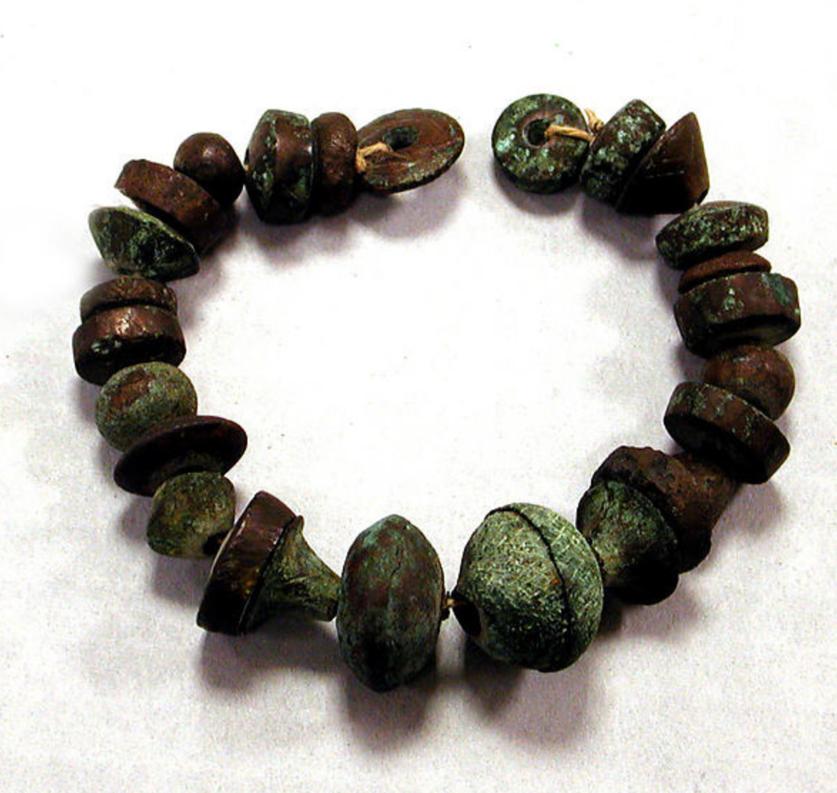 Copper and ceramic beads/whorls, 1200-1470 CE, Peruvian - The Metropolitan Museum of Art   https://www.metmuseum.org/art/collection/search/309223