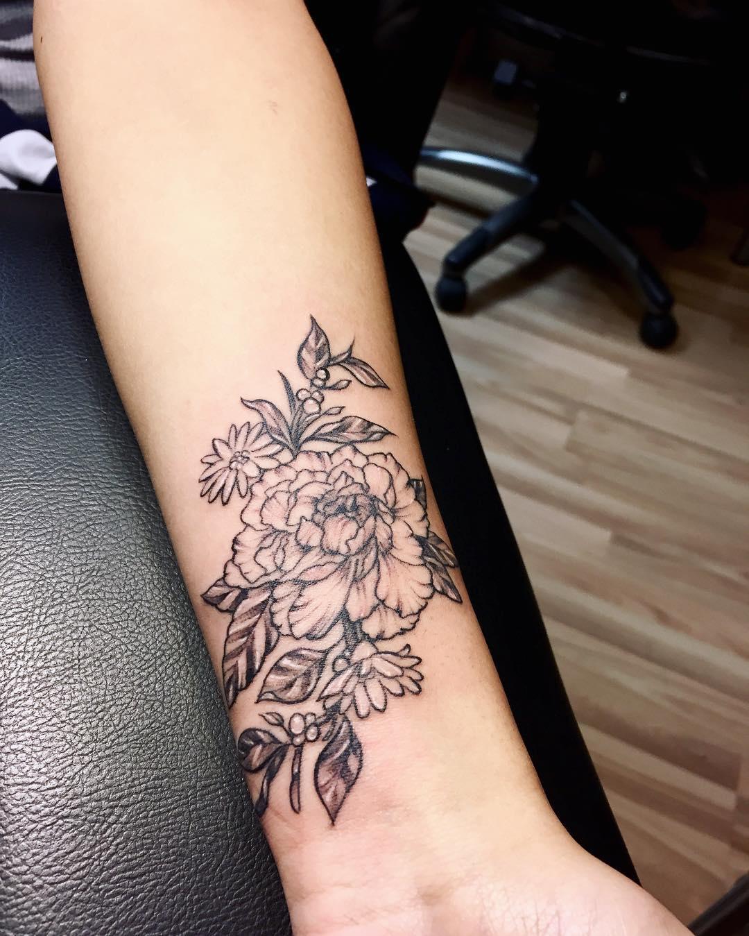 Peonies_and_flower_tattoo_on_wrist.jpg