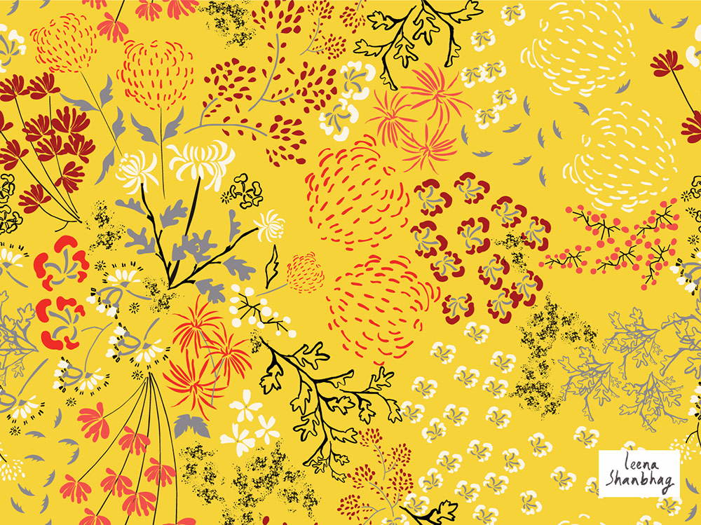 A ditsy floral pattern of red flowers on a bright yellow sunny pattern