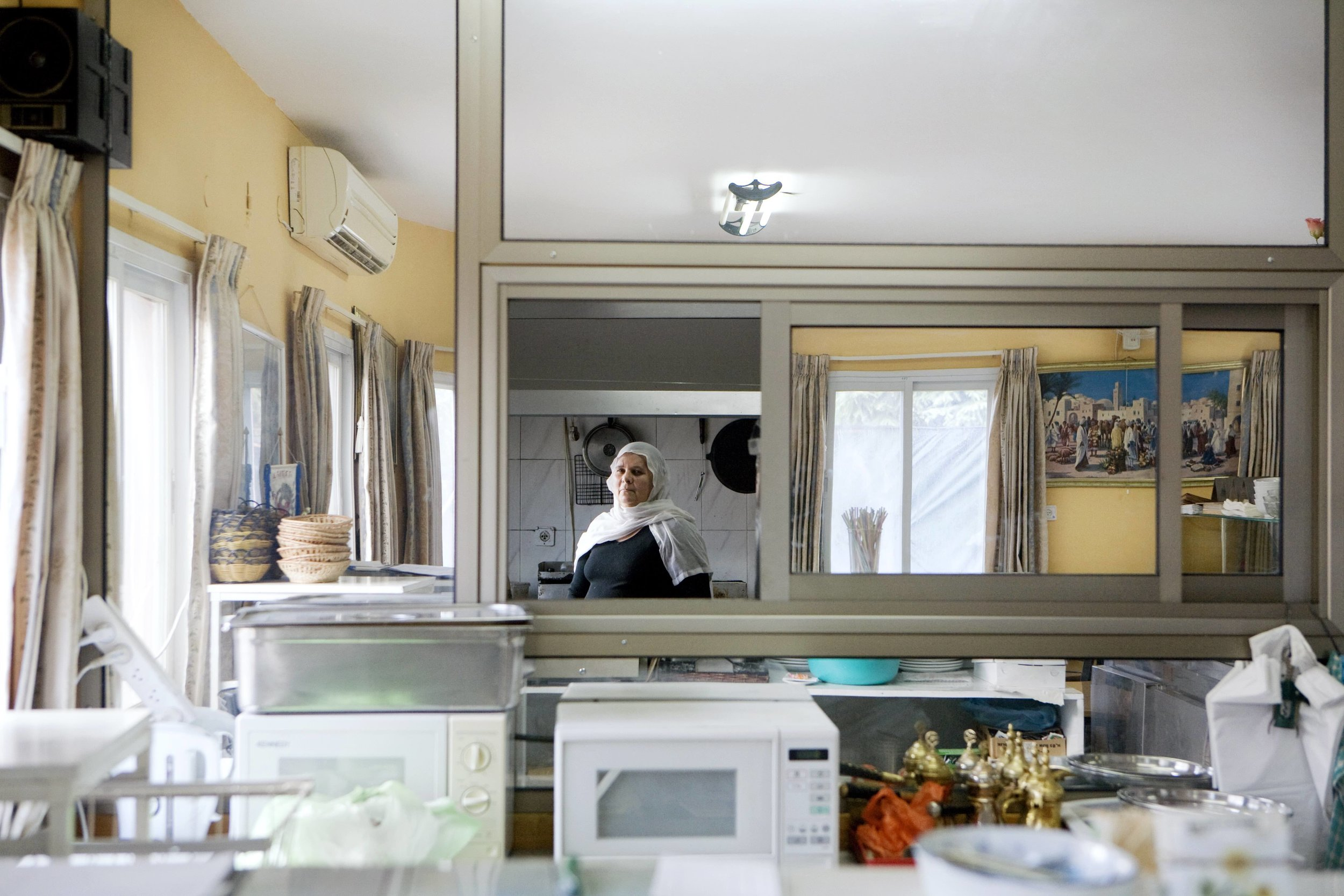 A Druze woman behind the restaurant counter  / Galilee, North of Israel 2012