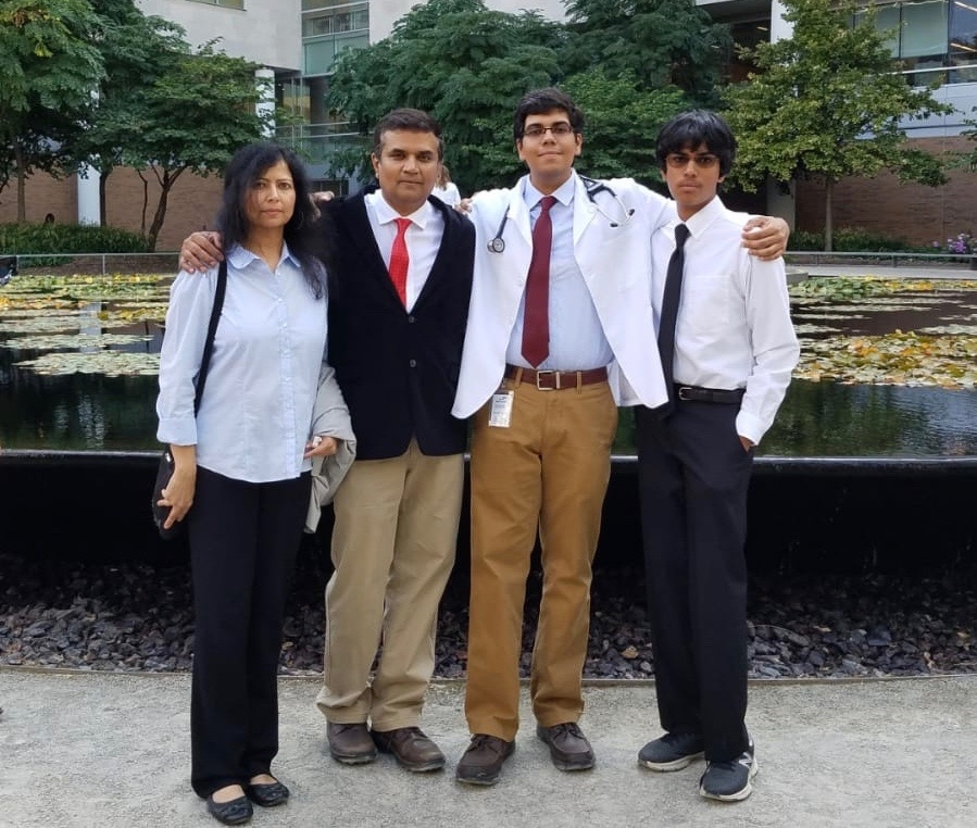 Srini with family, at a White coat ceremony for his son