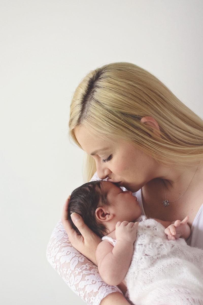 mommy-kisses-newborn-photography.jpg