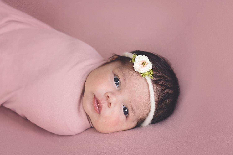 newborn photograph of an awake baby