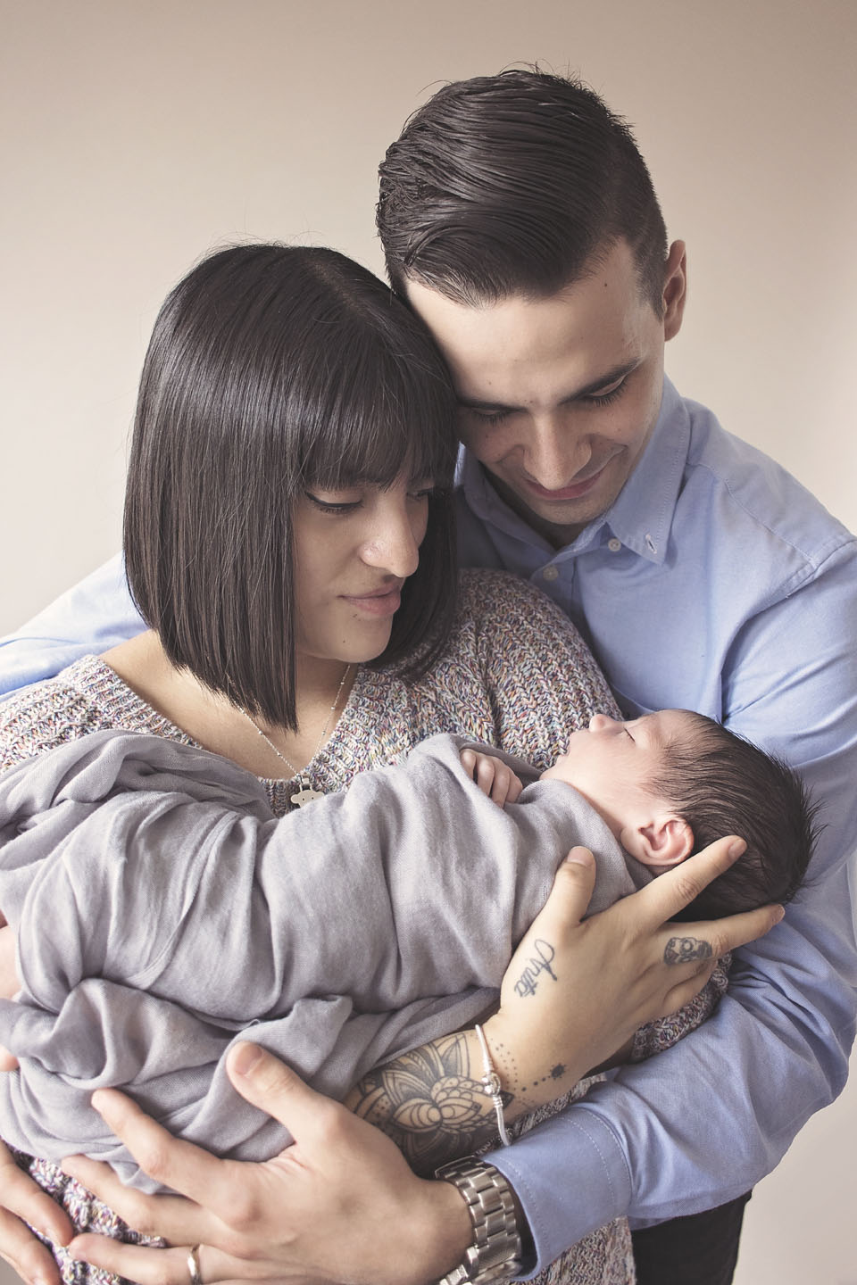 first time parents with their newborn baby boy