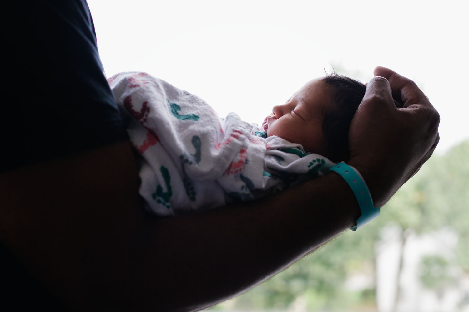 Fresh 48 Newborn Photography of baby in dad's arms at Valley Hospital in Ridgewood, New Jersey