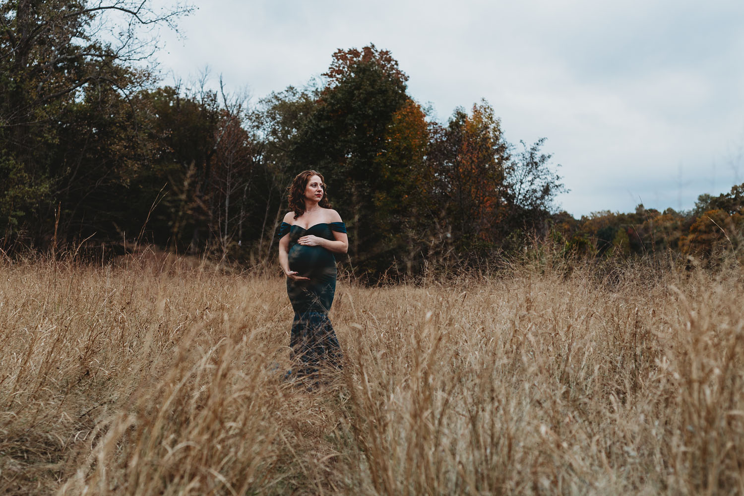 Maternity Photography of pregnant woman holding her belly in Clifton, New Jersey