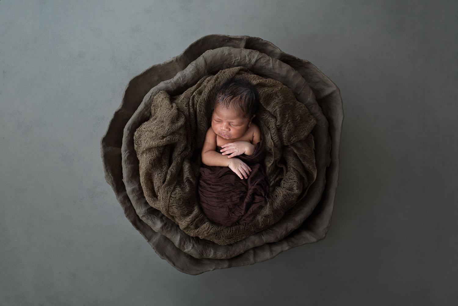 Newborn photography of a baby boy in a basket in new jersey