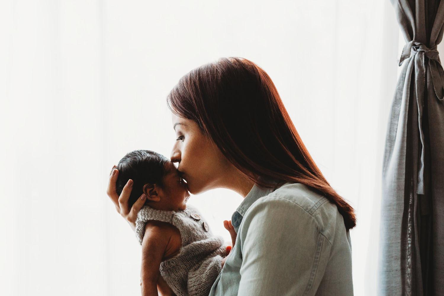 Lifestyle newborn photography of a baby boy and his mom in Lyndhurst New Jersey