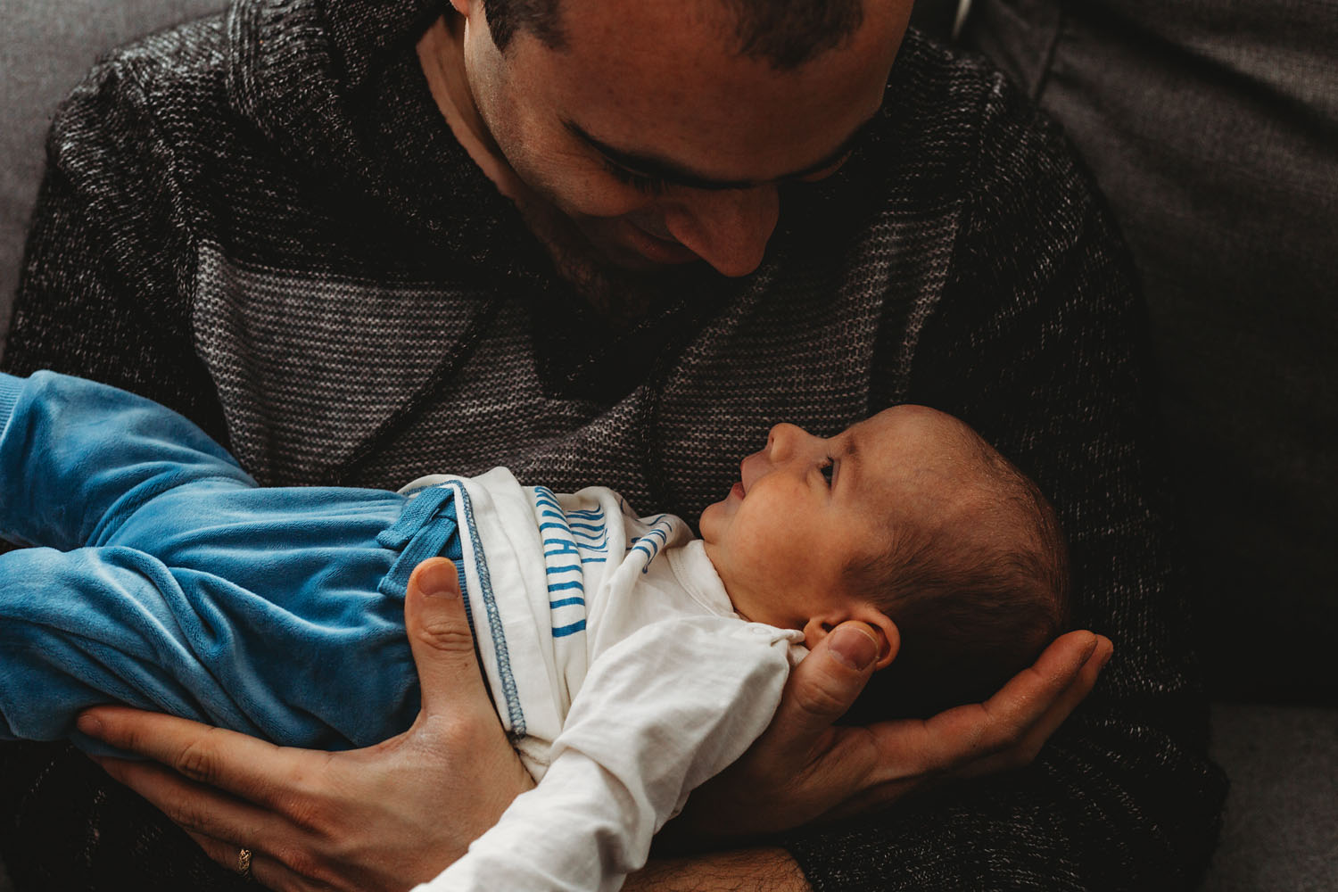 in home newborn photography of a baby and his dad in rutherford new jersey