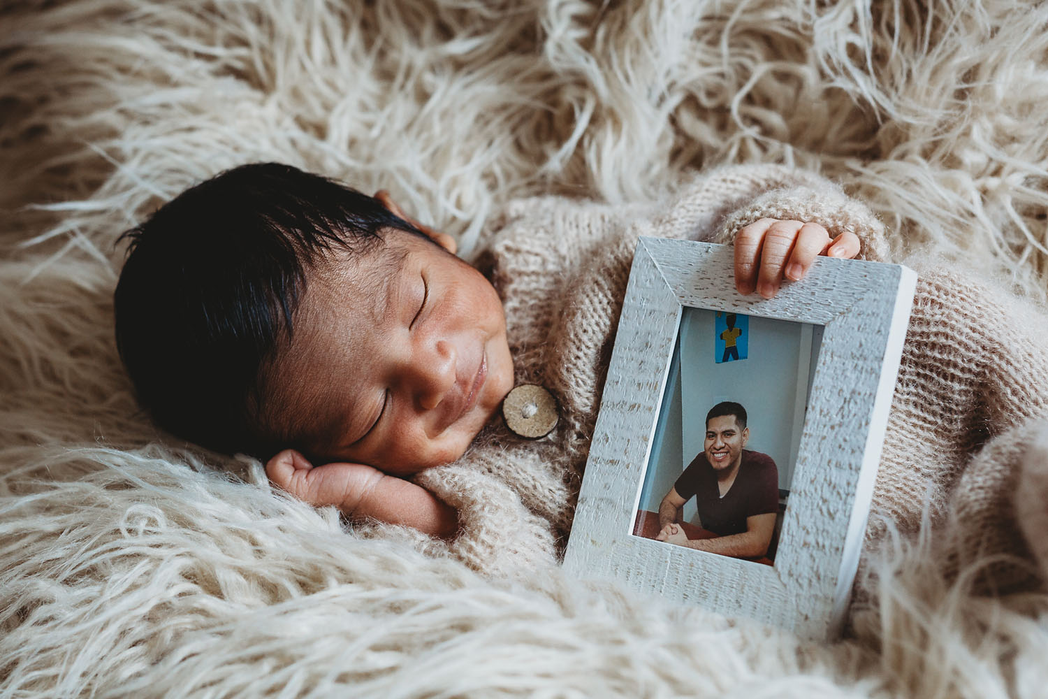 in home newborn photography of a baby and a picture of his father in lyndhurst nj