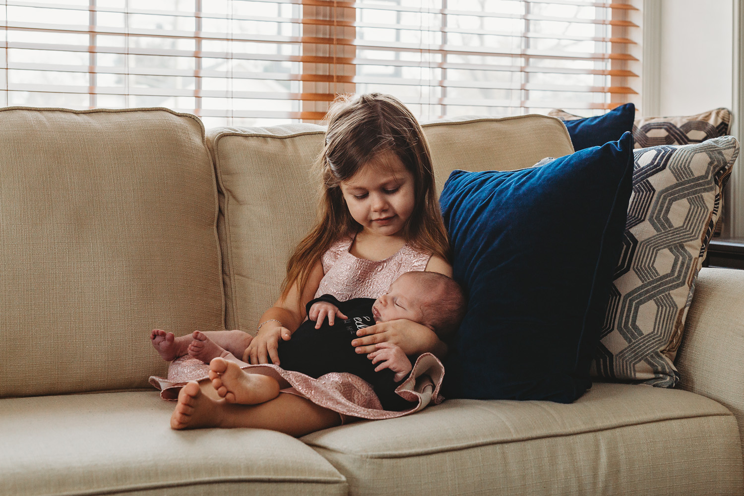 newborn photograph of a baby and his big sister in their new jersey home