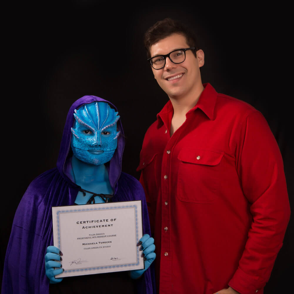 tyler and student graduation.jpg