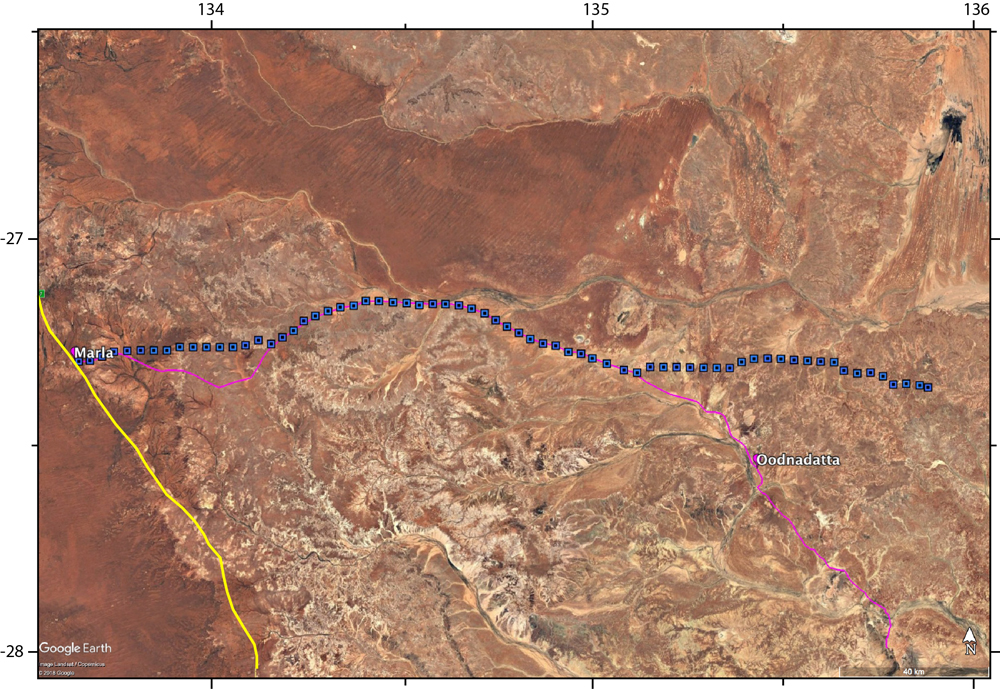Map showing the locations of the seismic array. The Stuart Highway is shown in yellow, the Oodnadatta track is shown in magenta and the seismic stations are shown as blue squares.
