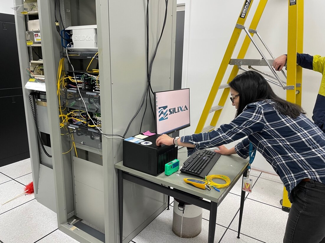 Voon Hui Lai sets up the DAS interrogator for the first time in the DSN server room. Image: Meghan Miller