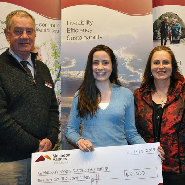 Isabella Lane from MRSG's new Youth action group receives the cheque from Cr Henry Bleeck and Mayor Cr Janet Pearce.