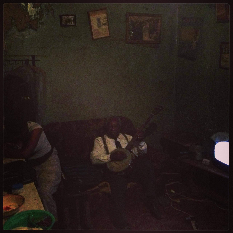 Chechamba at home with banjo.