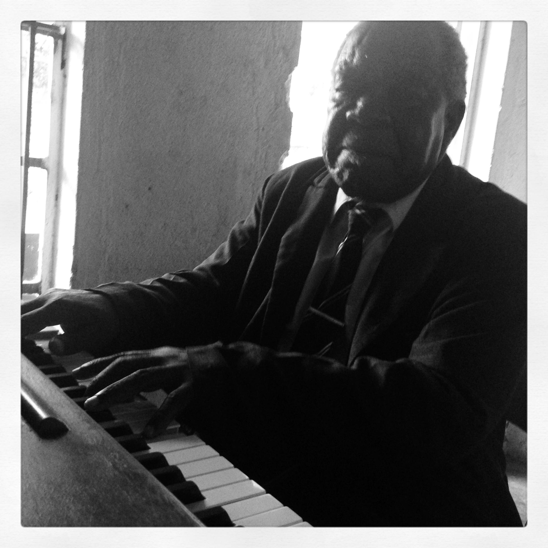 At the piano.