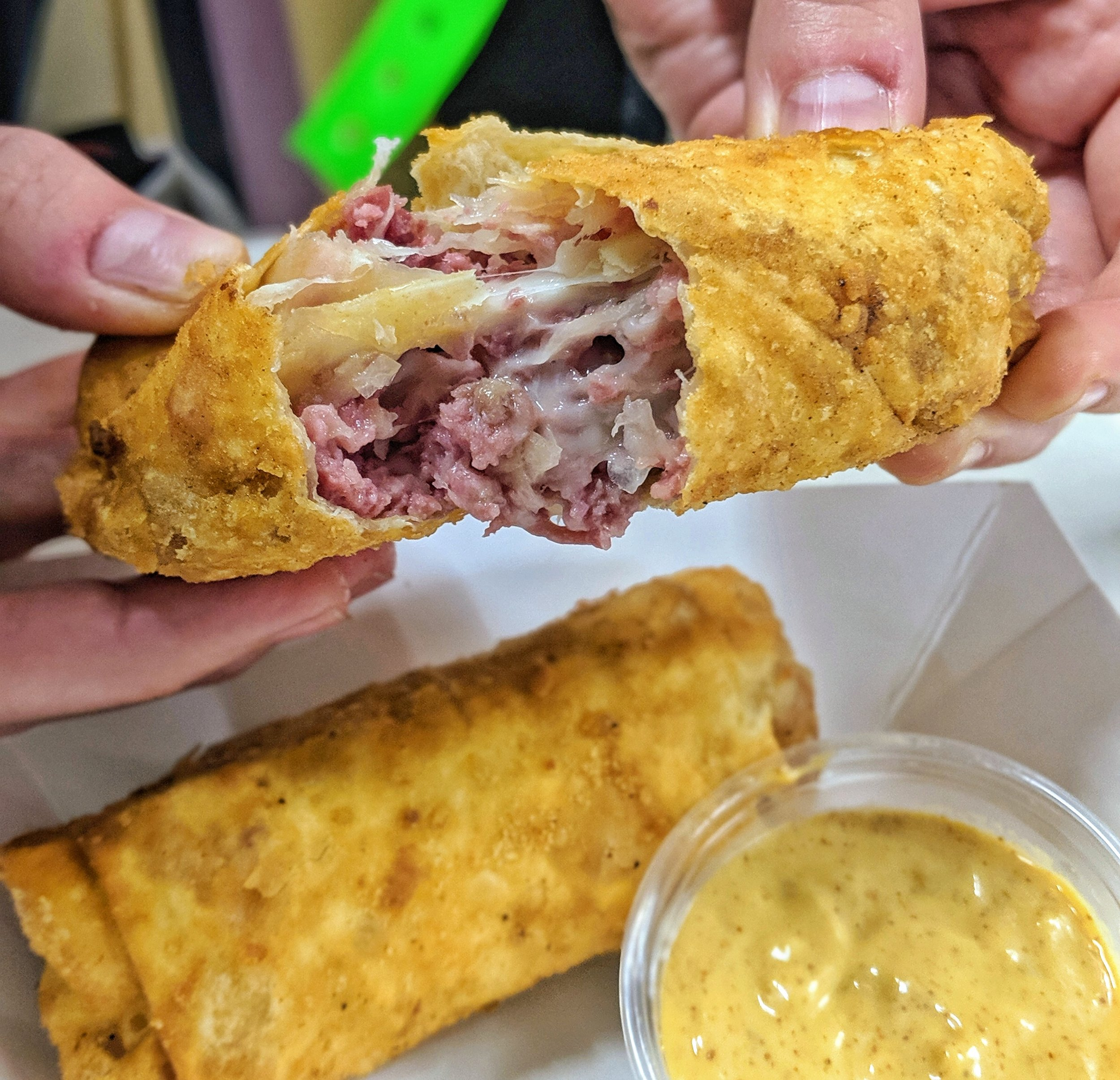 #2. Reuben Egg Rolls - When I first started stalking the Summerfest food lineup a few weeks ago, the Buffalo Chicken Eggrolls were on the top of my list to try. Once we got there Mike insisted that we try the Reuben Eggrolls from Mader's since he had eaten them a few years ago and loved them. The Reuben Eggrolls are stuffed with Corned Beef, Swiss Cheese, Sauerkraut and served with a Zesty Mustard Sauce.