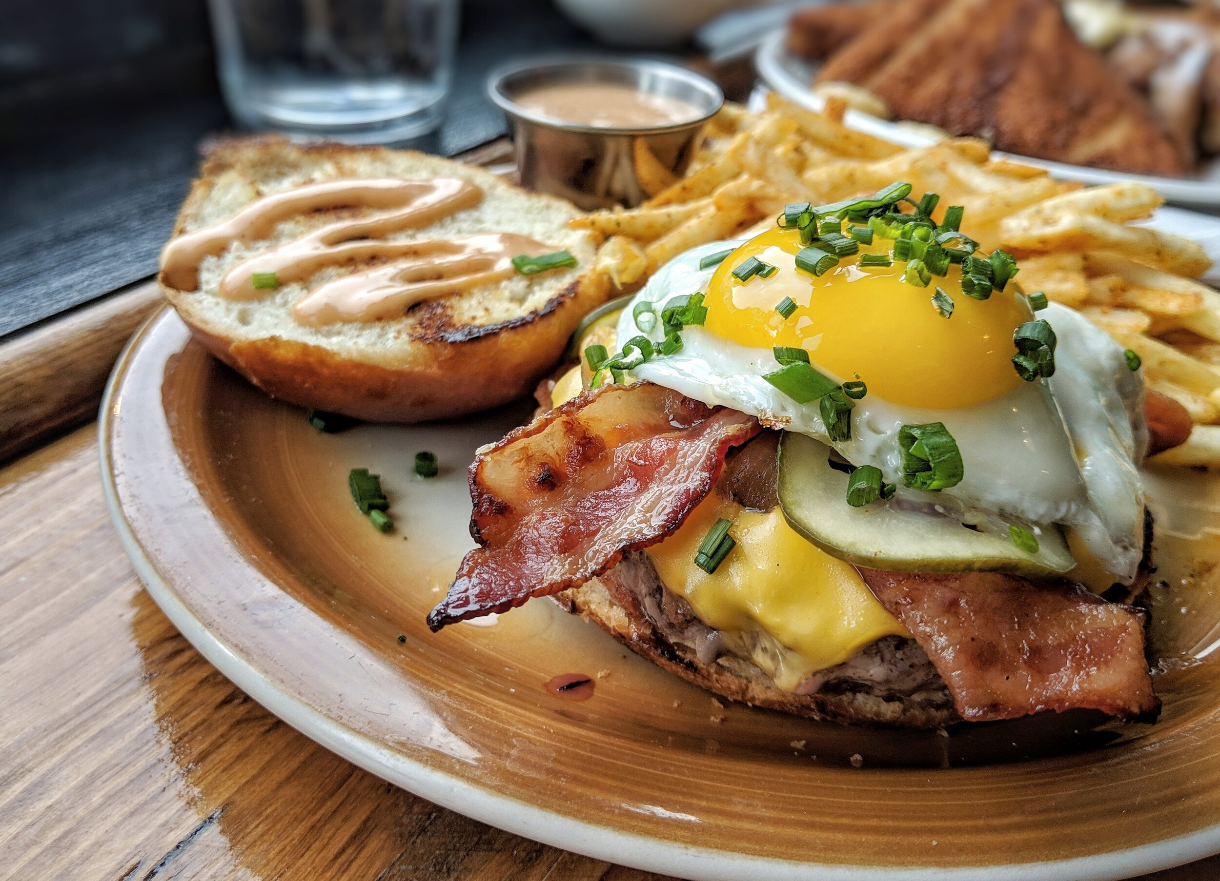- The Breakfast Burger from The Delta is topped with American Cheese, House Pickles, Onions, a Fried Egg and D.A.F. Sauce.