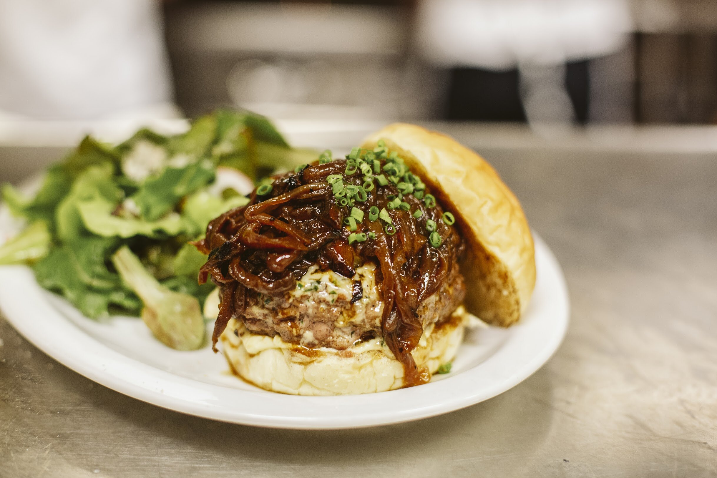 - The Graze Burger from Graze is a Patty made with Ground Short Ribs, Brisket and Bacon, then topped with Caramelized Onion-Cabernet Jus, Hook's Swiss Cheese and Emmental Compound Butter.Photo from @krosalesphotography