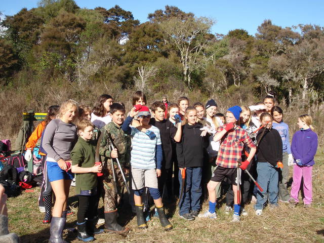The Hilltop School Weedbusters on ground removed of weeds at Oruatua.