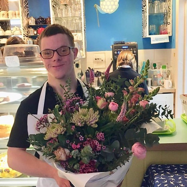 Daniel receiving our Random Acts of Flowers bunch at SWALLOW Community Cafe