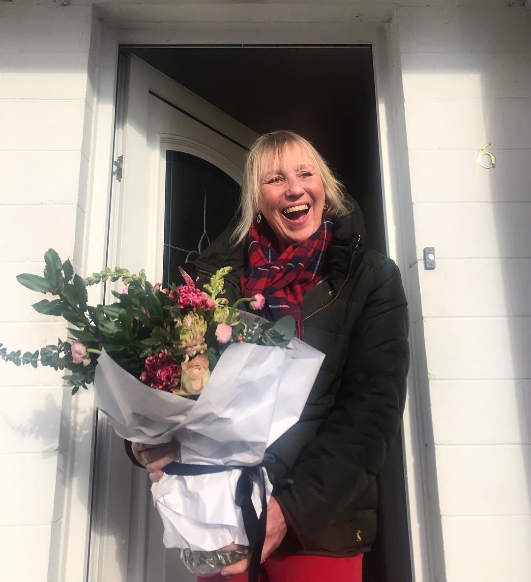 Mum receiving her Random Act of Flowers