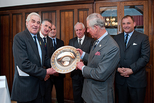 HRH The Prince of Wales receives the Royal Smithfield Club Bicentenary Trophy from John Coultrip (Immediate Past President of The Royal Smithfield Club)    Behind – Left to Right:  John Campbell (Past Club Chairman), Julian Hopwood (Club Chairman Elect), Rees Roberts (2011 Trophy winner) and Angus Stovold (Club Chairman)
