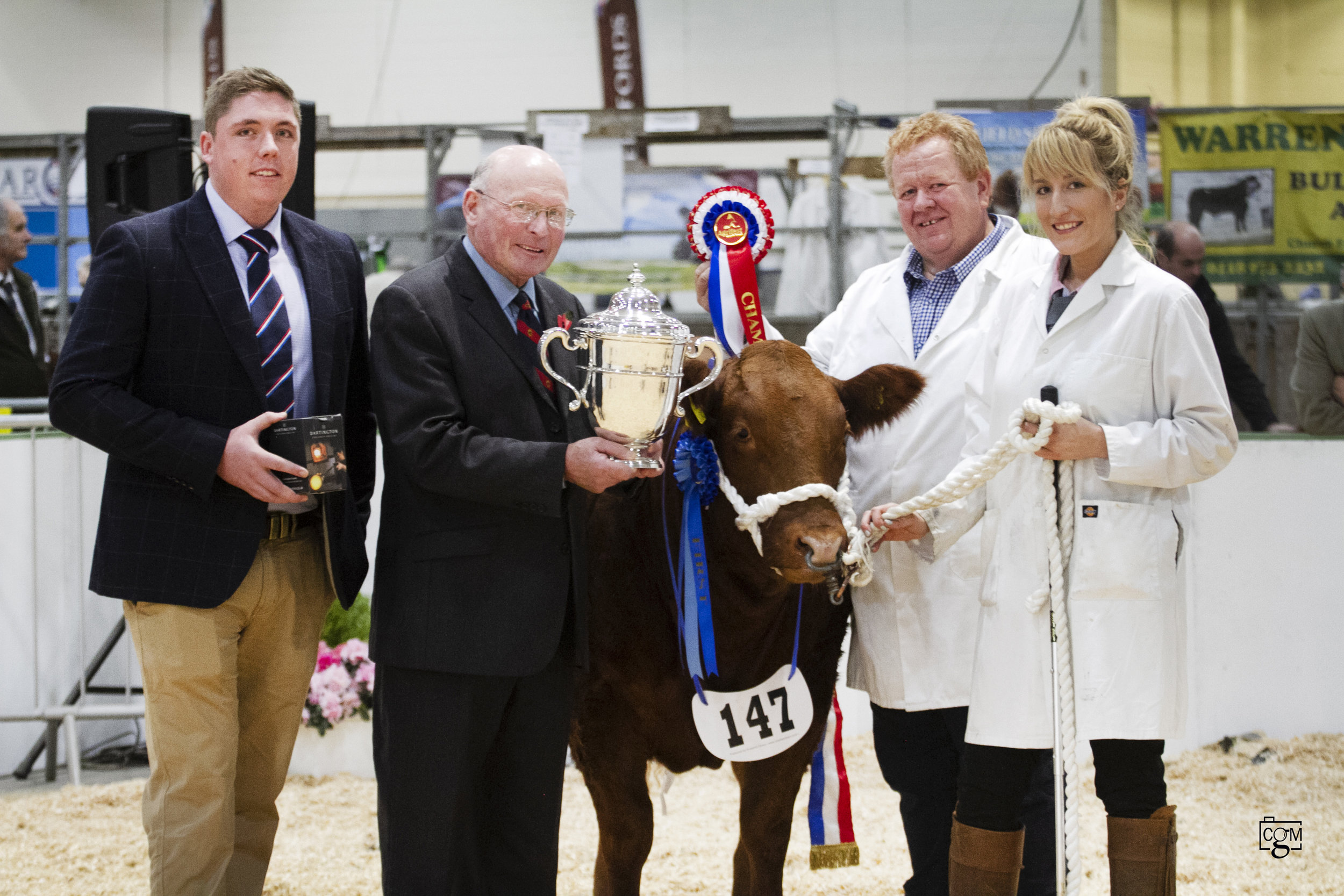 Robert Sloman, Hon Treasurer Royal Cornwall Agricultural Association, presents the Smithfield trophy to Cattle Champions Messrs Morgan & Jones