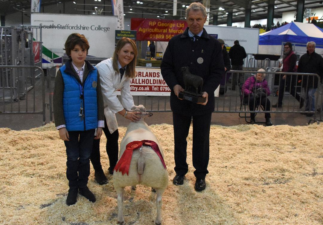 RABI Single Butchers Lamb winner Sarah Priestley pictured with Royal Smithfield Club Chairman, William Bedell, and son Freddie
