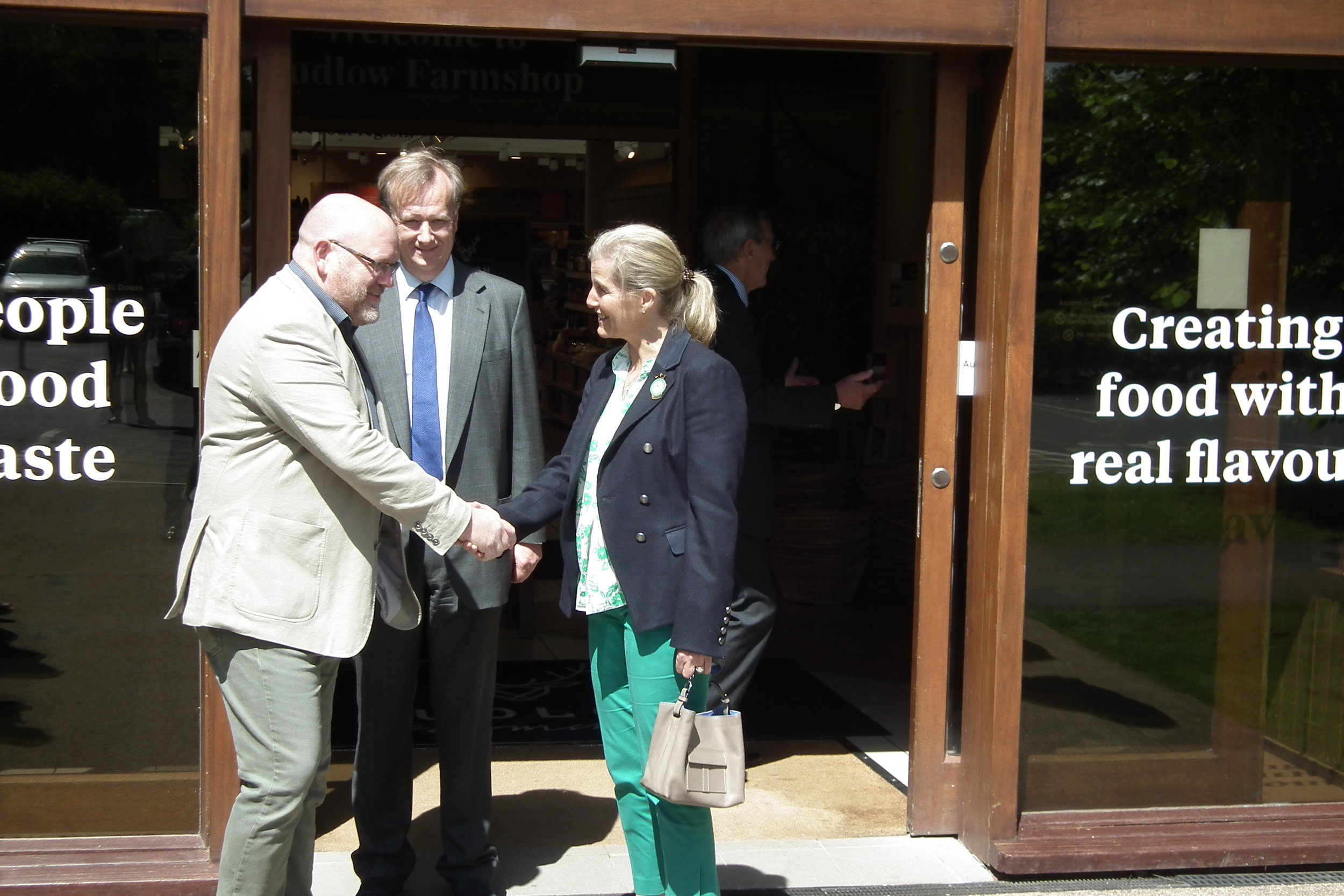 The Club's President HRH The Countess of Wessex is met by the Hon David Windsor-Clive & Jon Edwards, MD at Ludlow Farmshop