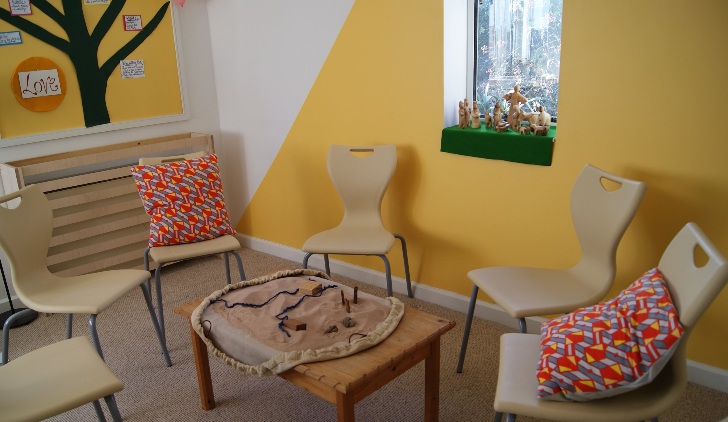 Stories for the Soul office - Our office at St Bart's Training Centre is used for storytelling, creative meetings and training. We painted it like a storytelling wigwam and used the colour of our logo to decorate it. The room is a bright airy space and inspiring to work in. The holy family fits well upon the window ledge as our focal shelf.