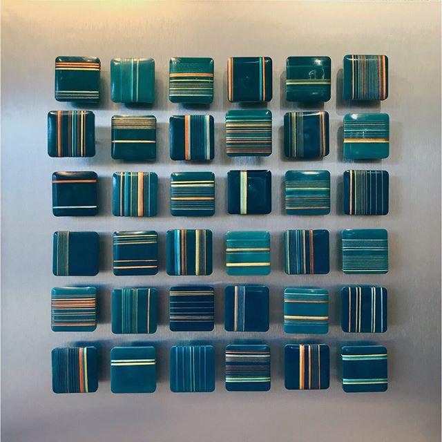 "'Line Dance in Saffron & Teal'. The first in an expansive new series. Encaustic tiles, felt & embroidery thread on aluminum, 24""x 24"". . . . . . #contemporaryart #mixedmedia #abstractart #artistsoninstagram #interiordesign #encausticart #ashevilleartist #lineart #minimalism #contemporaryartist #contemporaryartcurator #summeropening #grid #artoftheday"