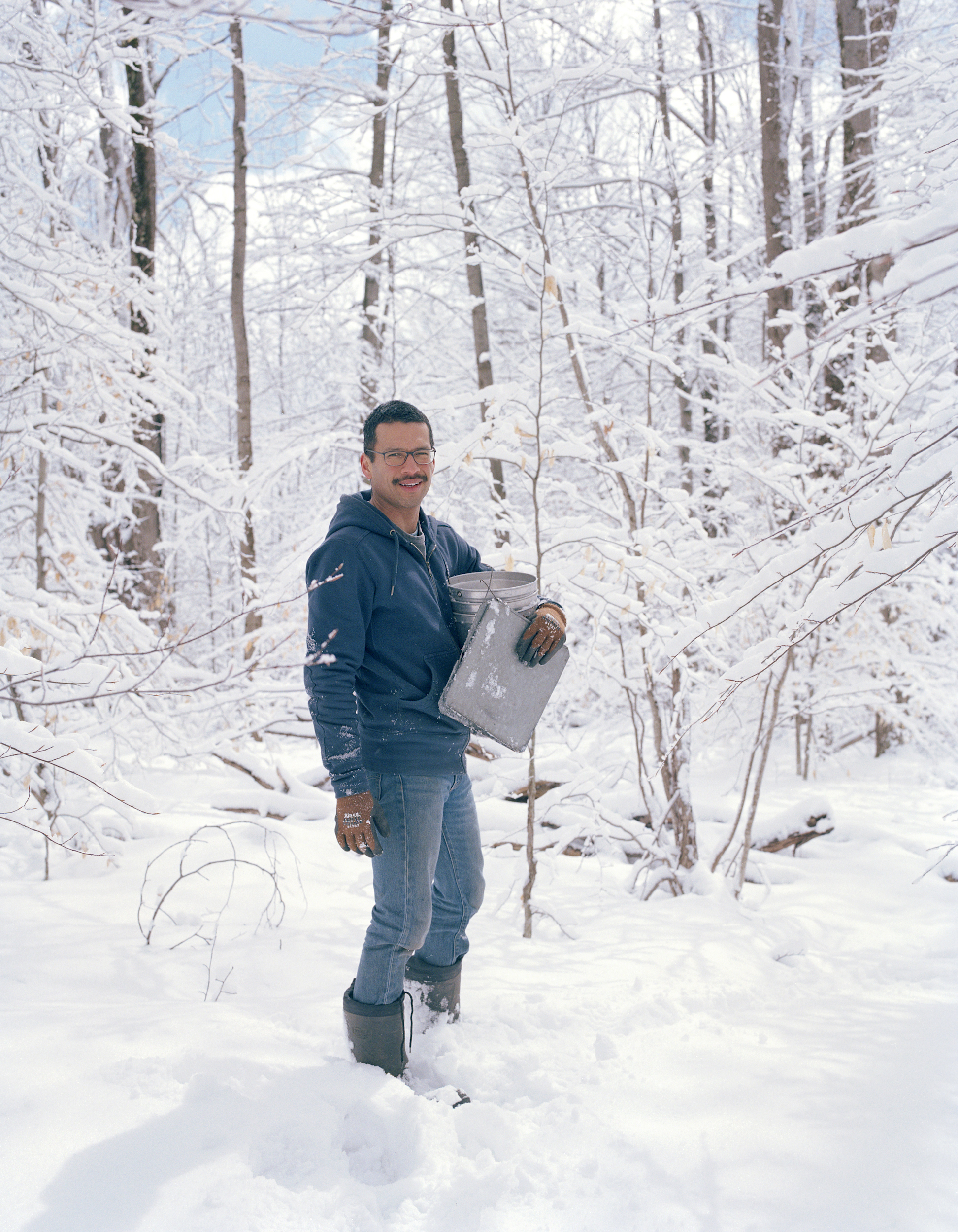 Simon collecting sap buckets in January 2018, a few weeks before him and Robert moved to Detroit. They moved to Stamford from New York City.