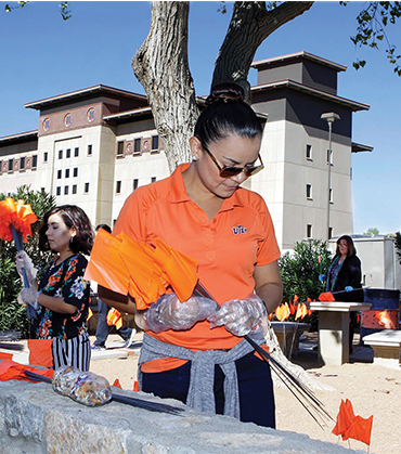 UTEP Tobacco Butt Pick-up   Orange flags were planted around campus where cigarette butts were found to bring awareness and in promotion of an upcoming great American Smokeout event.
