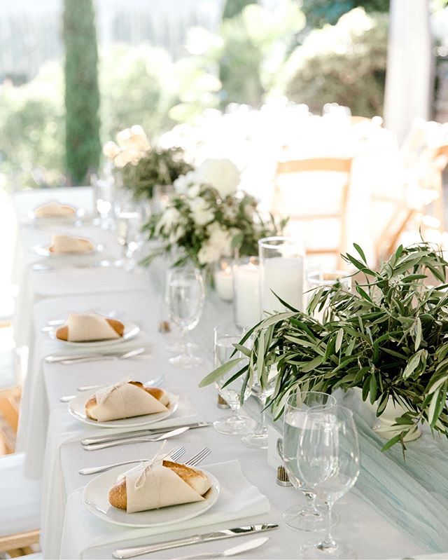 These olive branches and mini baguettes are giving me major French vibes, even though this wedding was at a winery right here in Woodinville, Washington! ⁣ Photography: @lora.lovess ⁣ Floral design: @gatherdesigncompany ⁣ Coordination: @petrarabson ⁣ Venue: @chateaulill ⁣ Catering: @alexascafeandcatering ⁣ Stationery (by the bride): @alexandrastudios