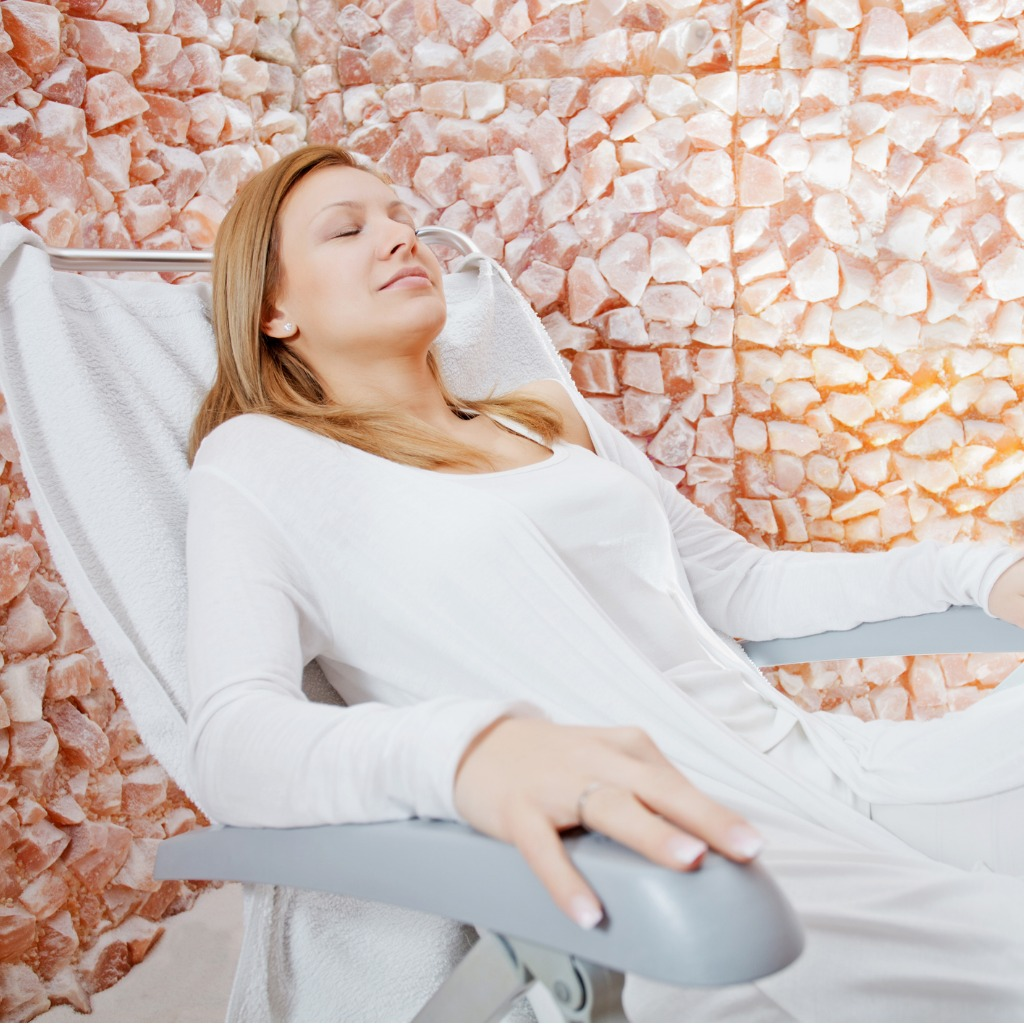 beautiful-woman-relaxing-in-salt-room-picture-id185087761.jpg