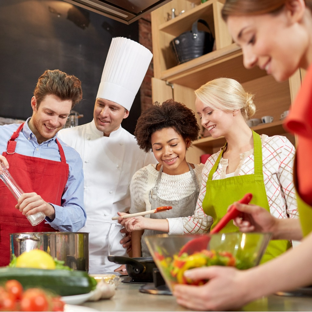 happy-friends-and-chef-cook-cooking-in-kitchen-picture-id485286424 (2).jpg