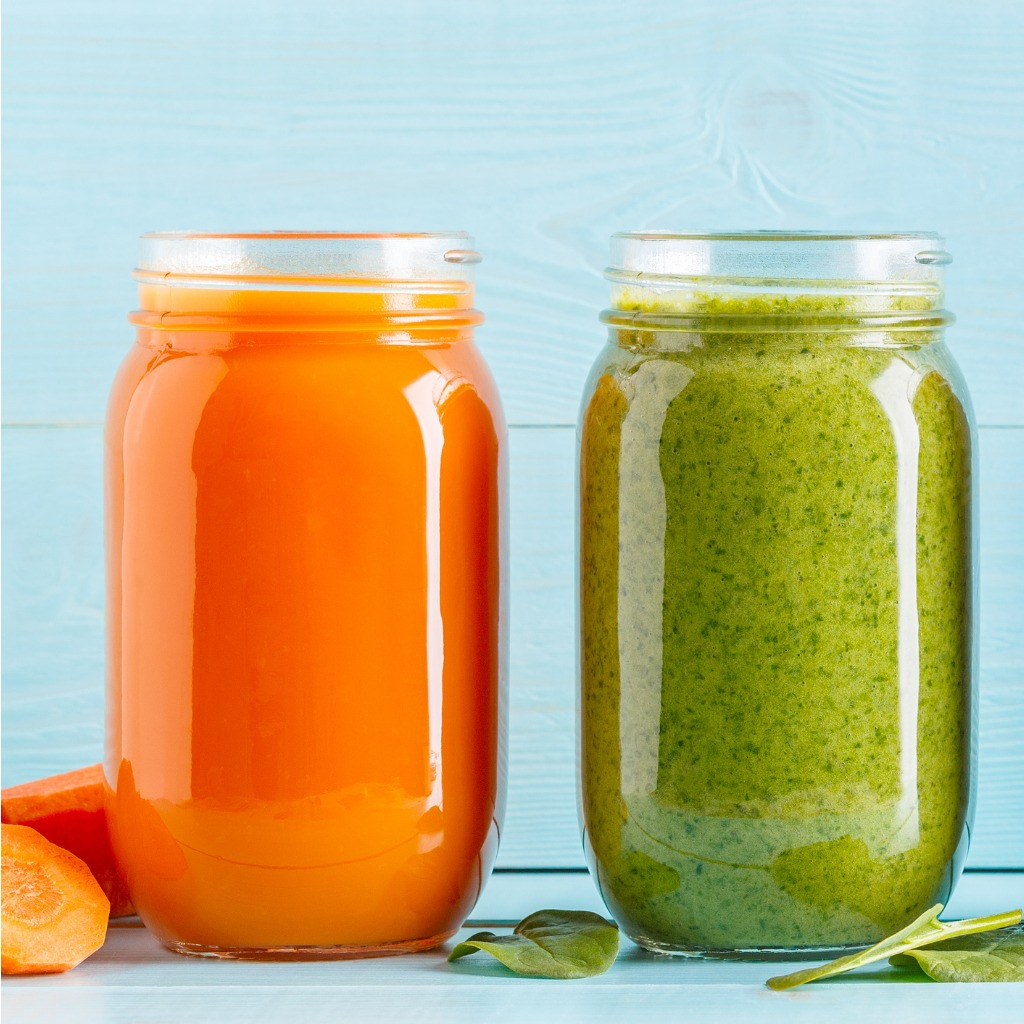 orangegreenred-colored-smoothies-juice-in-a-jar-picture-id929744186.jpg