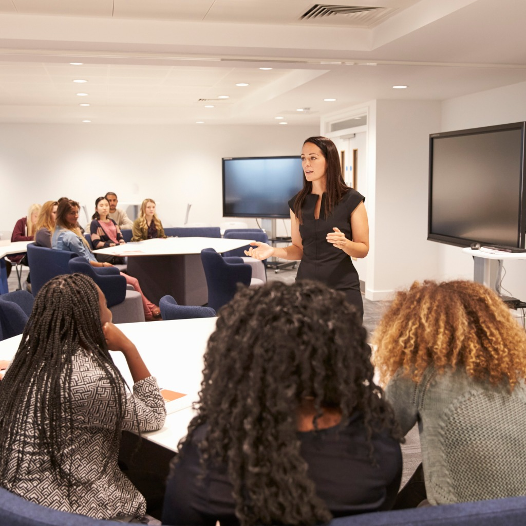 female-teacher-addressing-university-students-in-a-classroom-picture-id597959356 (2).jpg