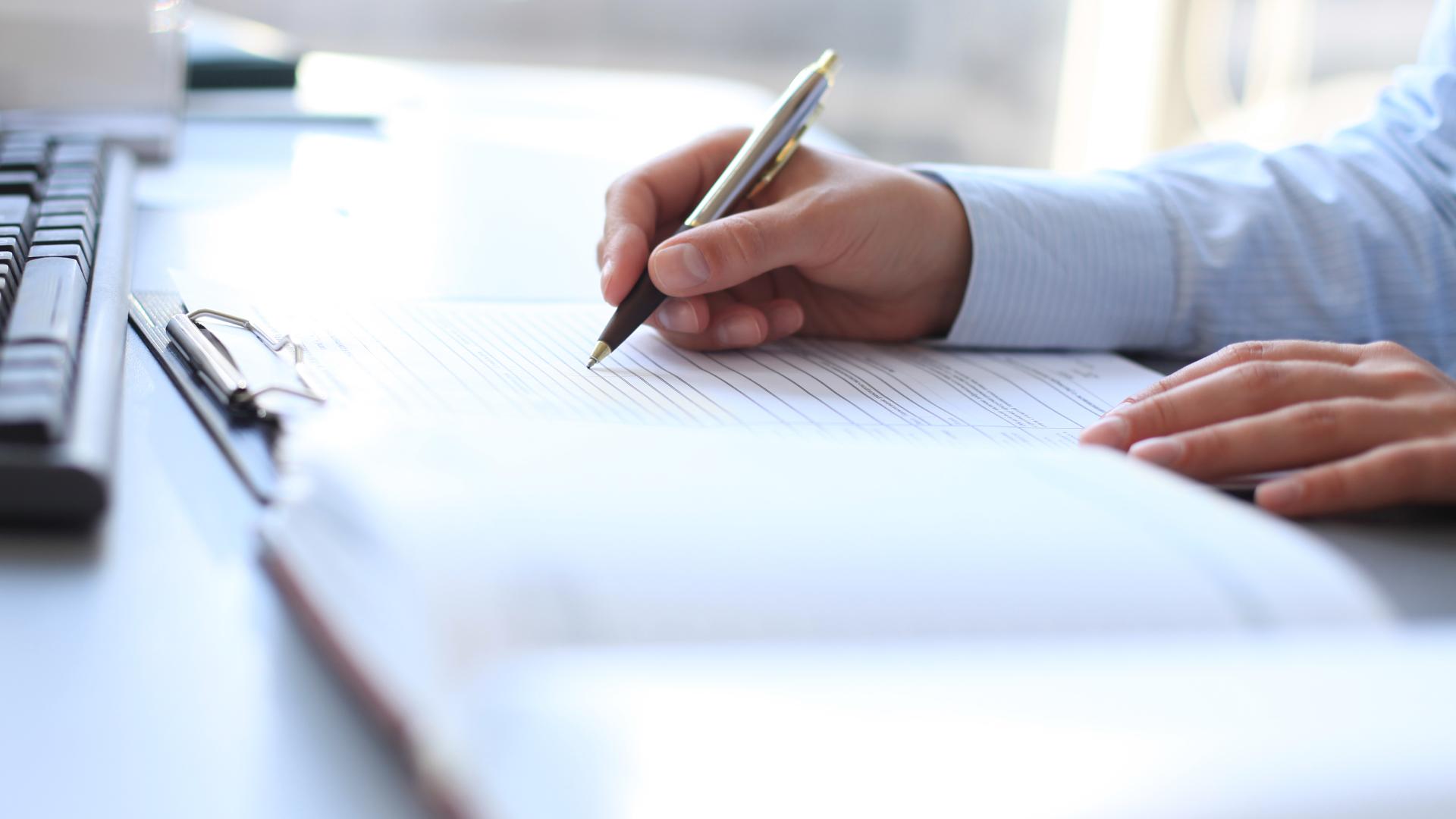 Pen signing paperwork